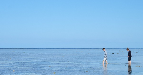 Two Global Change Scholars wading through ankle deep water on Lady Elliot Island